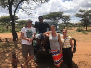 Maike, Niels and Namayiana staff Mpairo and Corinna in front of Landcruiser